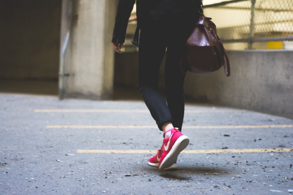 lady taking walk in red shoes